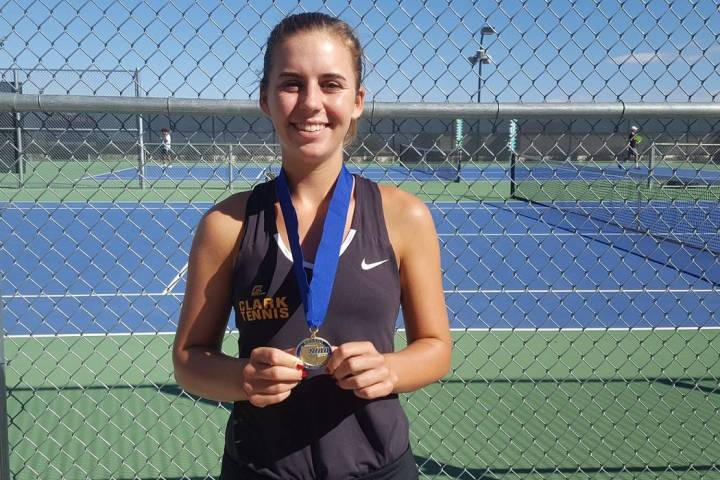 Clark junior Audrey Boch-Collins poses with her championship medal after defeating Bishop Go ...