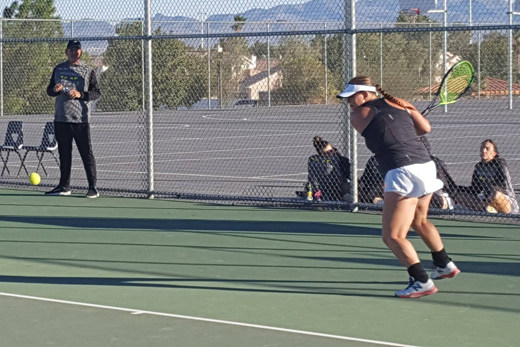 Palo Verde senior Shelby Graber prepares to return a shot in her singles match against Bisho ...