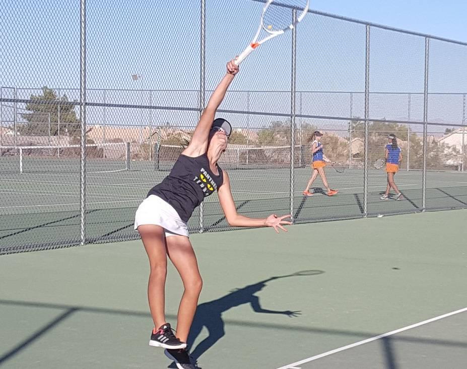 Palo Verde sophomore Lindsay Juhasz serves during her singles set against Bishop Gorman sen ...