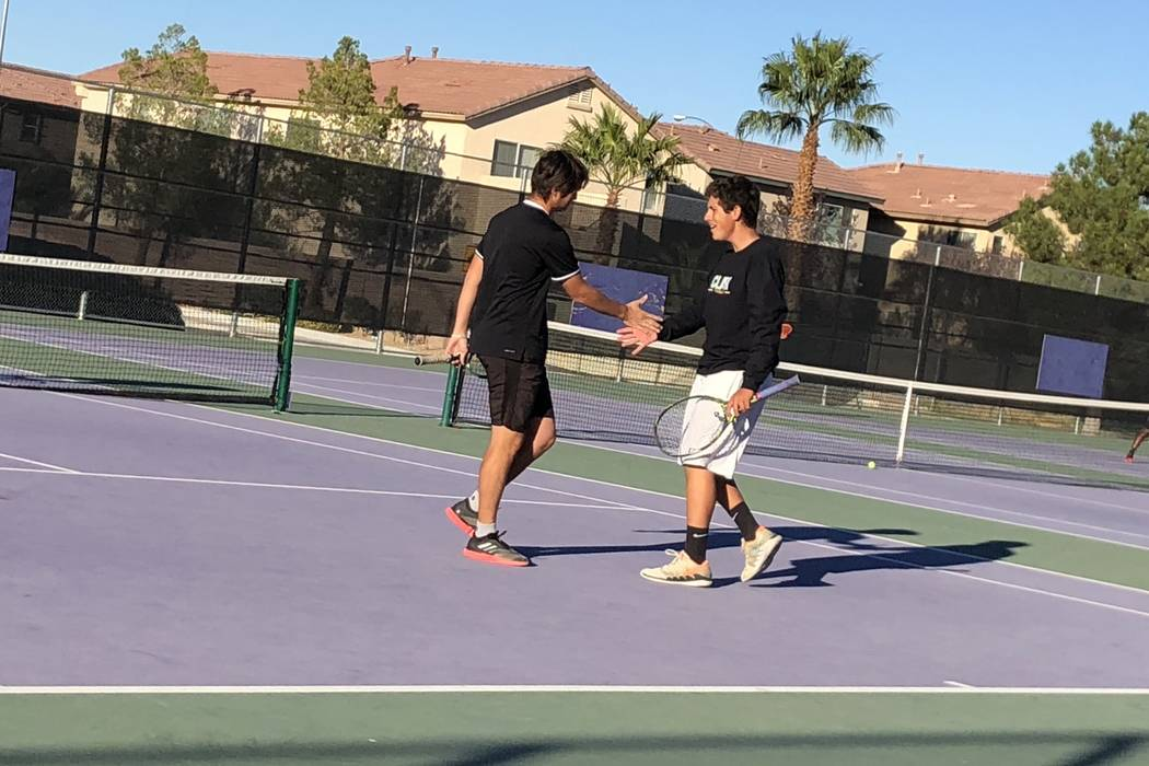 Clark's Artem Iermolov and Mathew Spagnolo celebrate a point during a doubles match ag ...