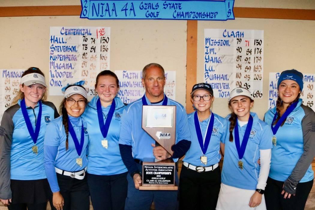 The Centennial girls golf team celebrates its Class 4A state golf championship at Dayton Val ...