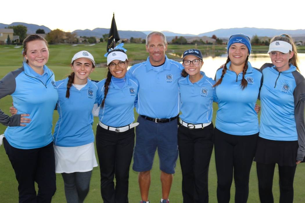 Centennial's golf team poses after winning the Class 4A state golf championship at Day ...
