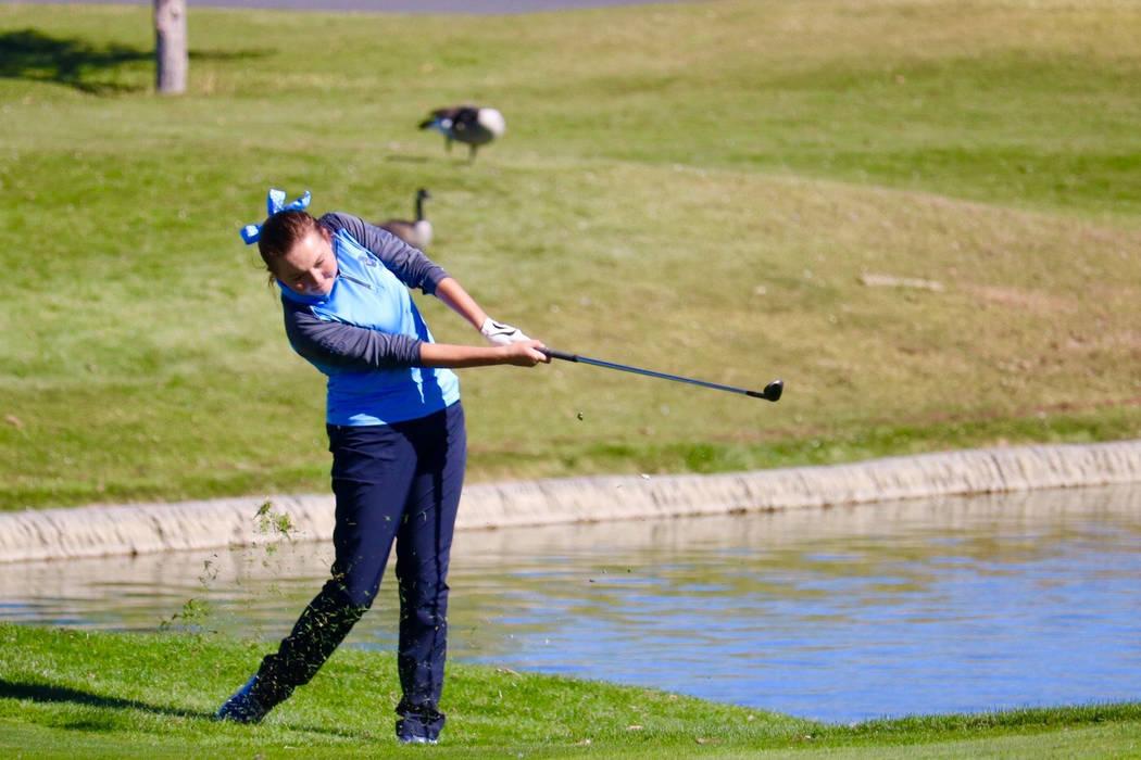 Centennial's Hailey Stevenson takes a shot during the Class 4A state golf tournament a ...