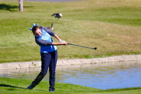 Centennial's Hailey Stevenson takes a shot during the Class 4A state golf tournament a ...
