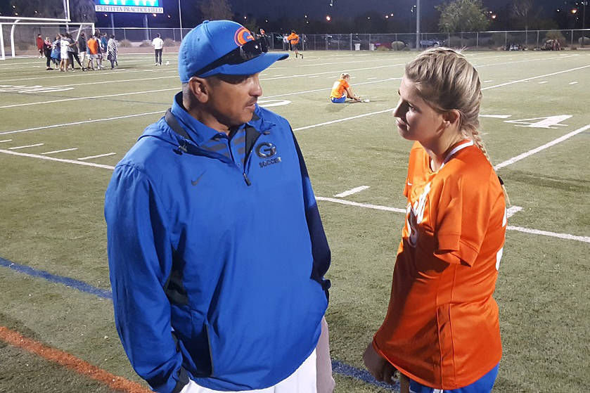 Bishop Gorman senior Gianna Gourley shares a moment with assistant coach Robert Andrade, aft ...