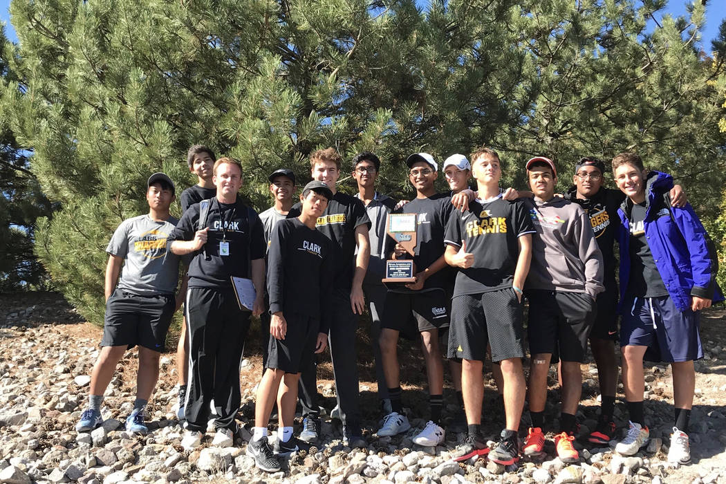 Clark boys tennis players pose with the Class 4A state runner-up trophy at Bishop Manogue Hi ...