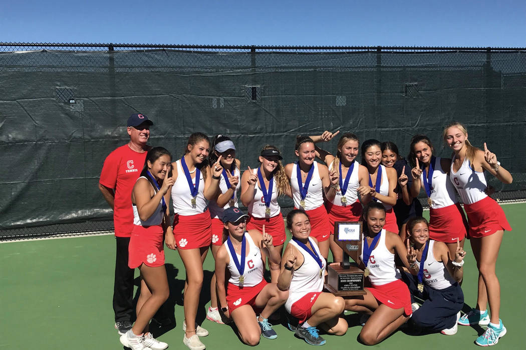 Coronado's girls tennis team poses for a photo with the Class 4A state championship tr ...