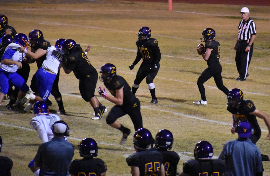 Durango's Kaden Renshaw drops back to pass on Friday against Bishop Gorman. (Courtesy ...