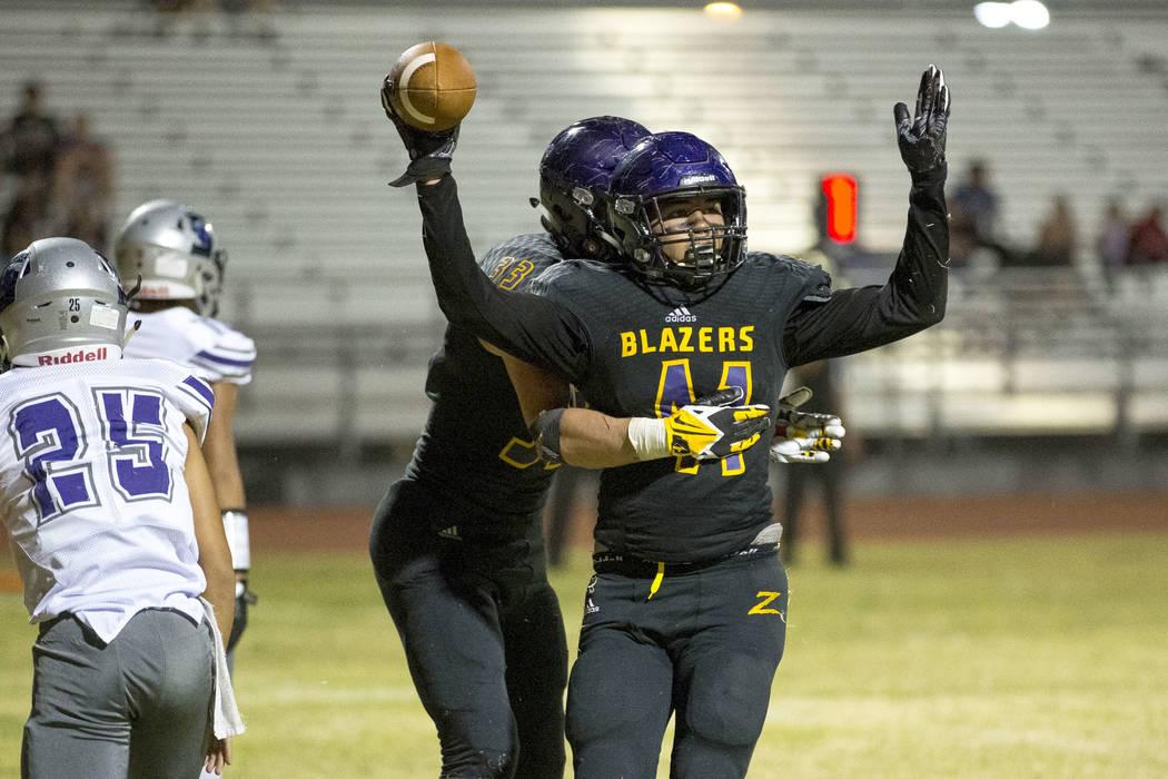 Durango's Frankie Pelton (41), foreground, celebrates his touchdown with Jayden Nersin ...