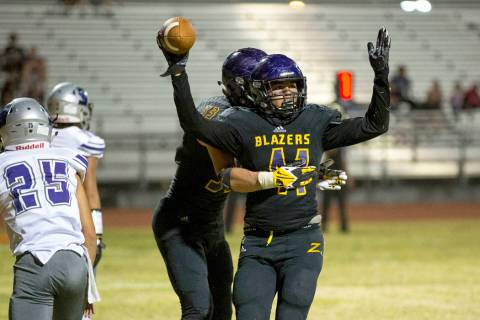 Durango's Frankie Pelton (41), foreground, celebrates his touchdown with Jayden Nersin ...