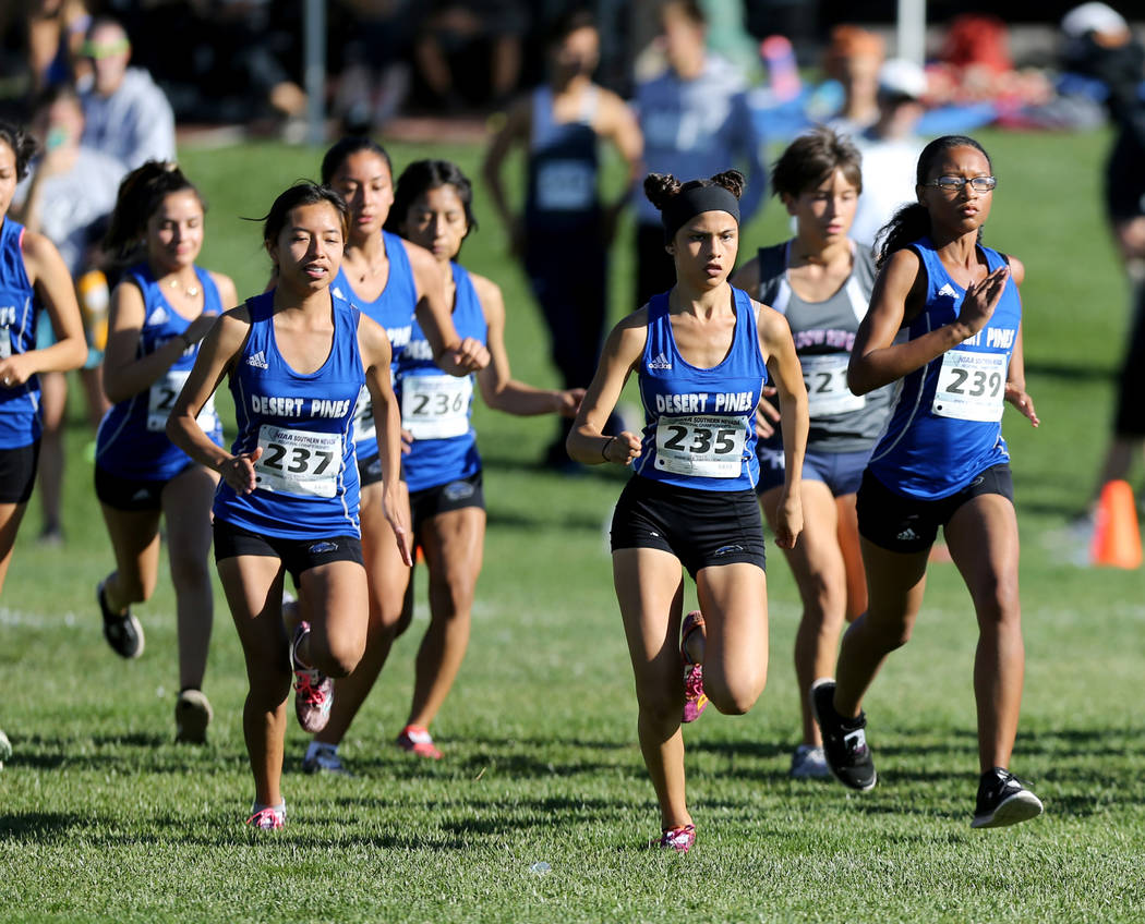 Desert Pines junior Jazmin Felix (235) leads her teammates at the start of the 4A Mountain g ...
