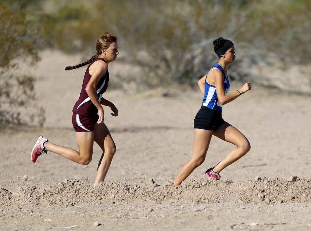 Desert Pines junior Jazmin Felix leads Cimarron-Memorial freshman Olivia Grace in the 4A Mou ...