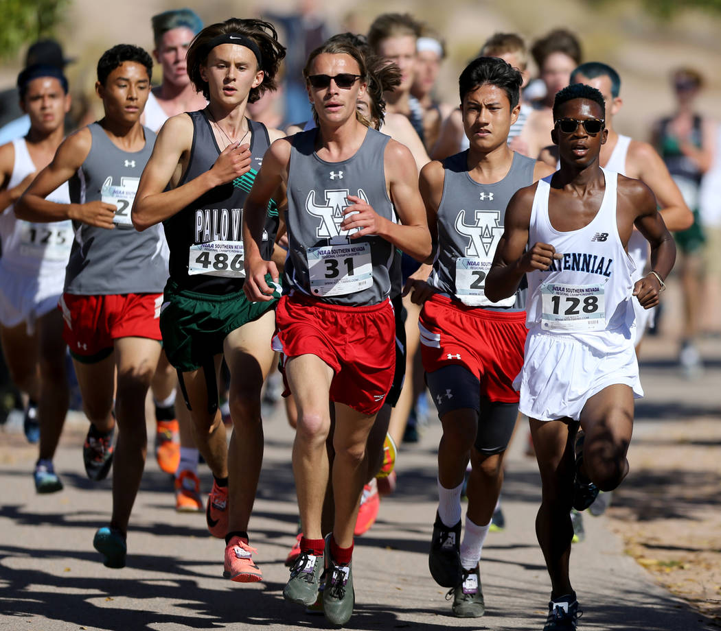 Runners during the 4A Mountain boys cross country region race at Veteran's Memorial Pa ...