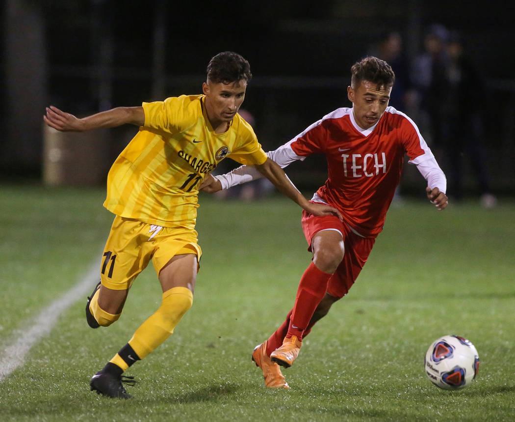 Clark High School's Juan Beltran Diaz fights for the ball against Tech's Jonatha ...
