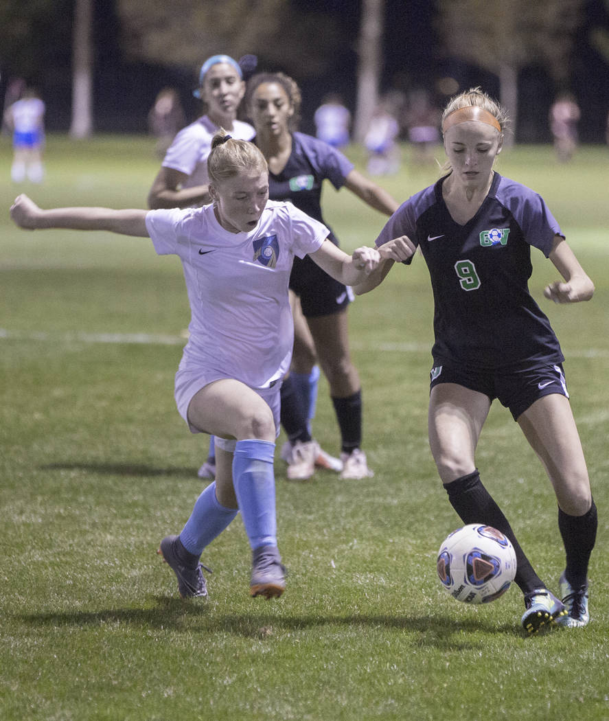 Foothill junior Haley Huff (2) fights for a loose ball Green Valley junior midfielder Grace ...