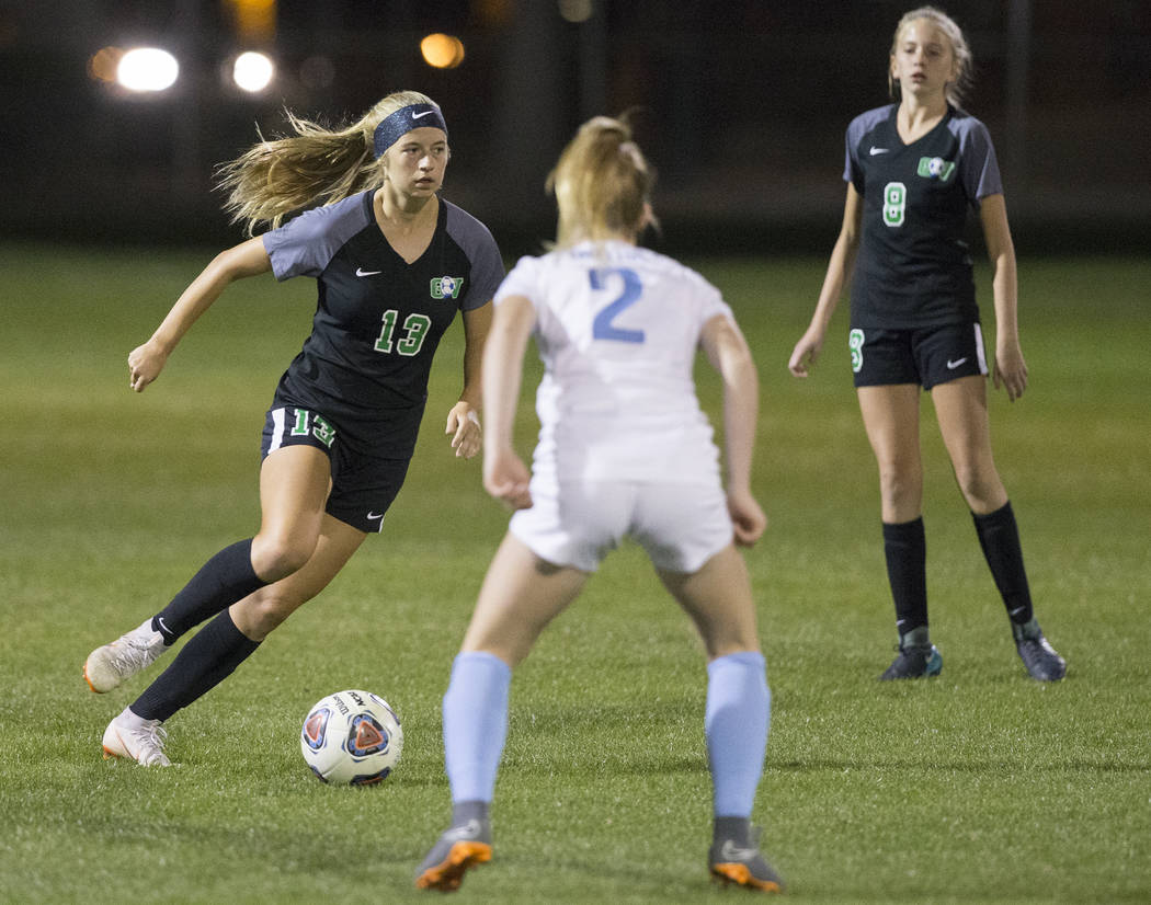 Green Valley sophomore midfielder Sydney Thomas (13) pushes the ball up field past Foothill ...