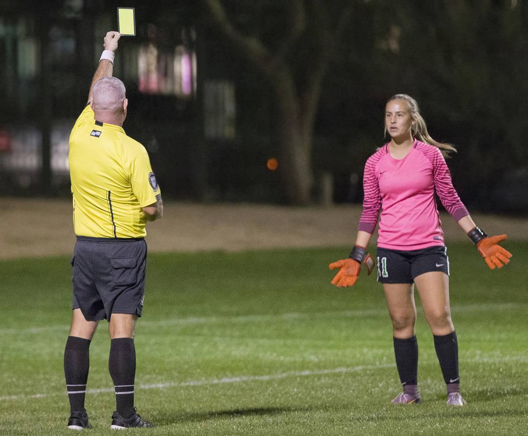 Green Valley junior goalkeeper Nicolette De La Carrera (11) reacts after receiving a yellow ...