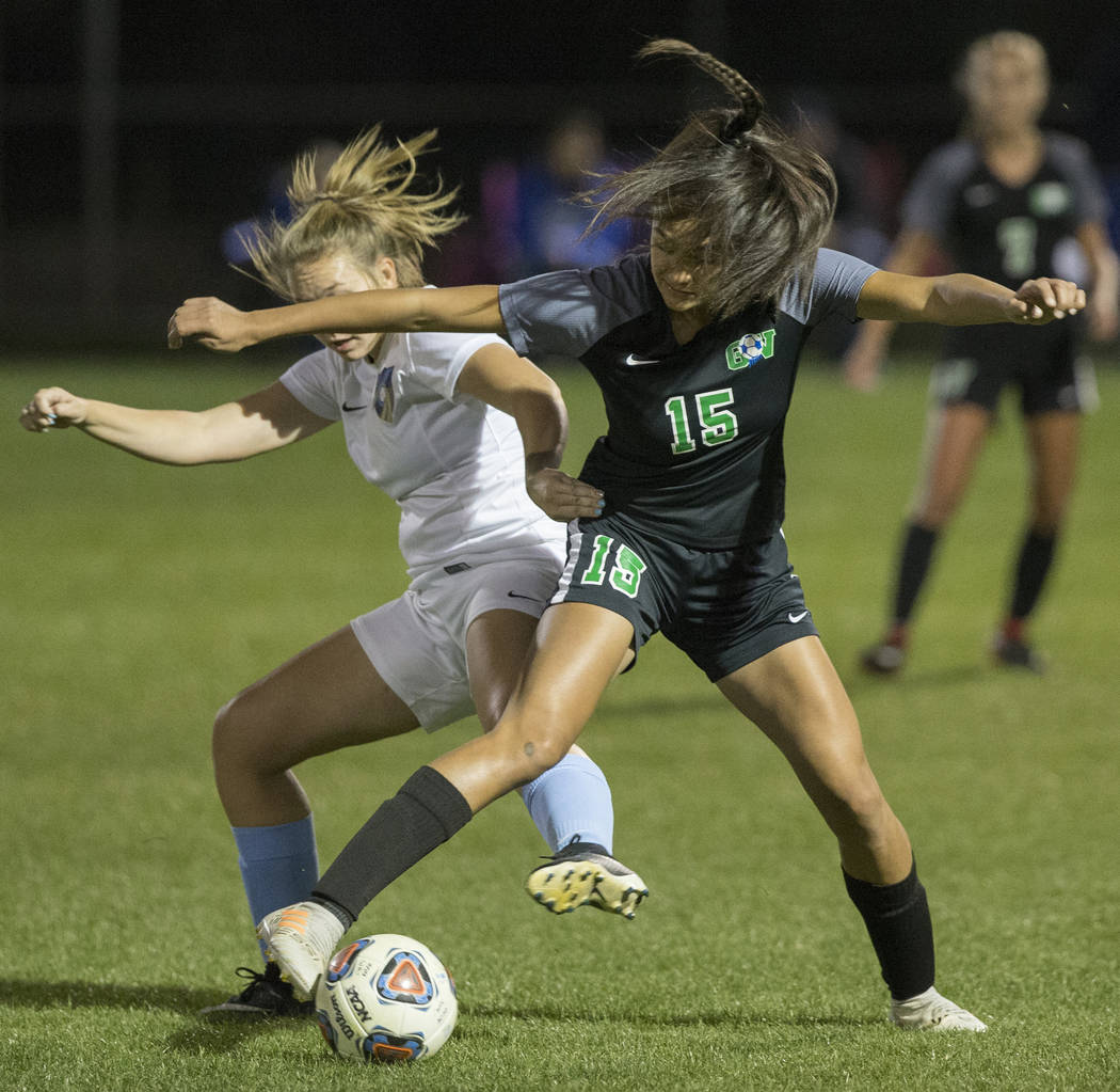 Green Valley junior forward Jazlyn Camacho (15) fights for a loose ball with Foothill senior ...