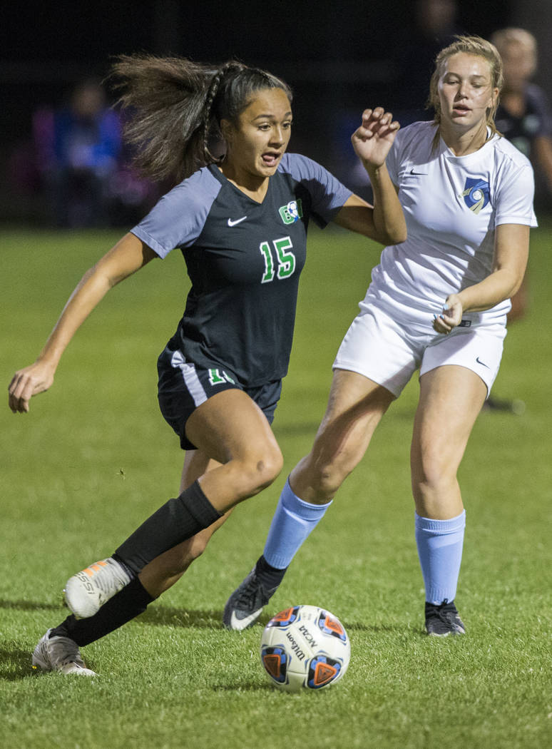 Green Valley junior forward Jazlyn Camacho (15) pushes the ball up field past Foothill senio ...