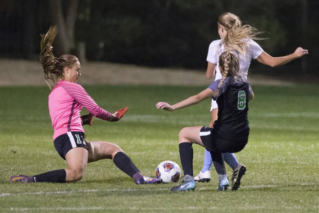 Green Valley junior goal keeper Nicolette De La Carrera (11) and teammate Ali Morton (8) def ...
