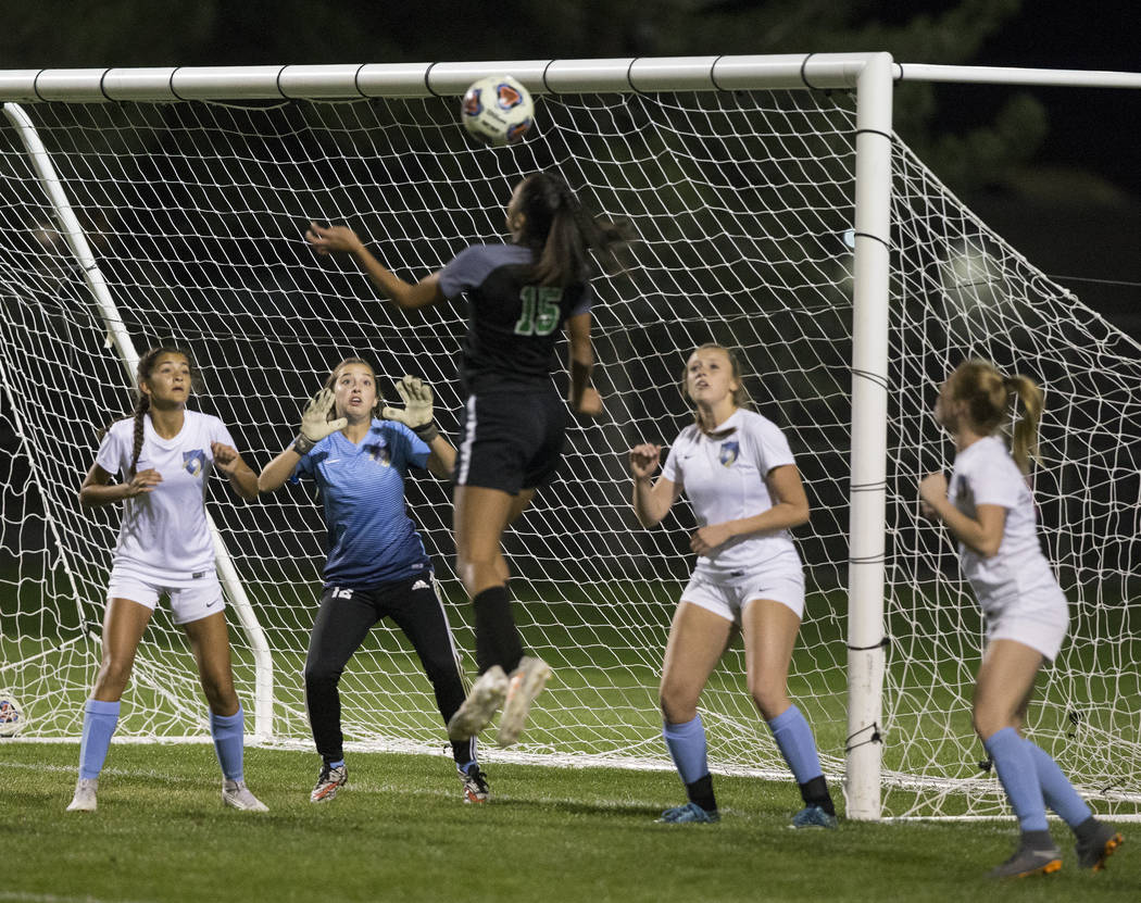 Green Valley junior forward Jazlyn Camacho (15) goes up for a header against Foothill High S ...