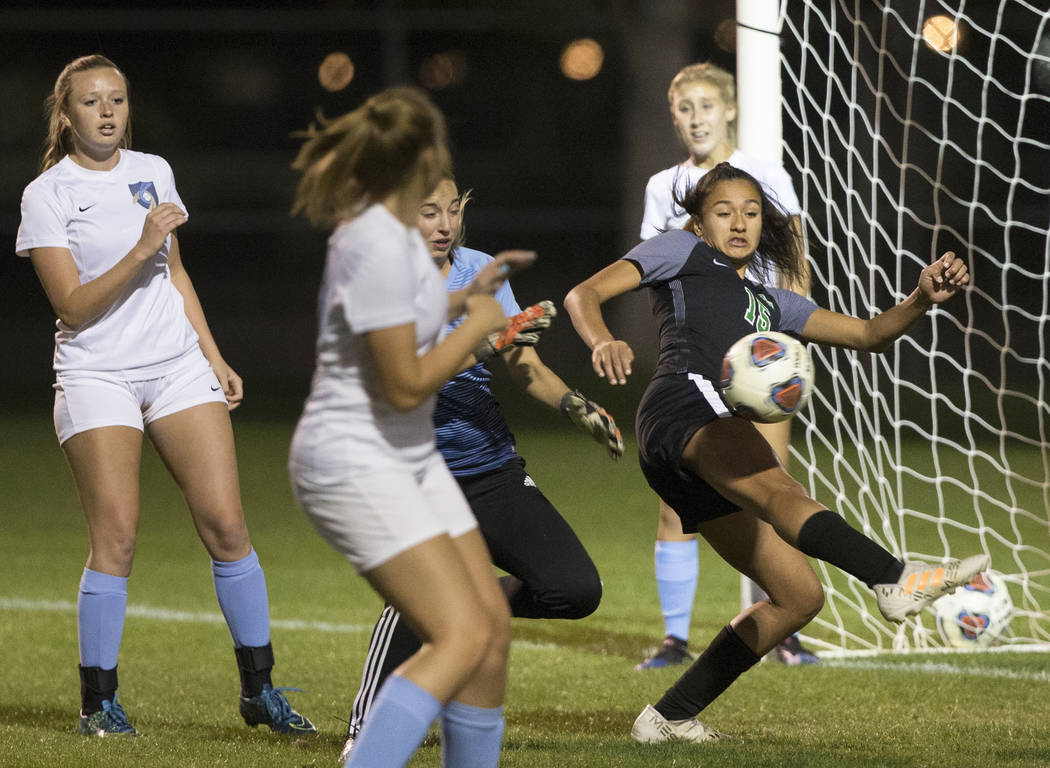 Green Valley junior forward Jazlyn Camacho (15) scores a second half goal against Foothill H ...