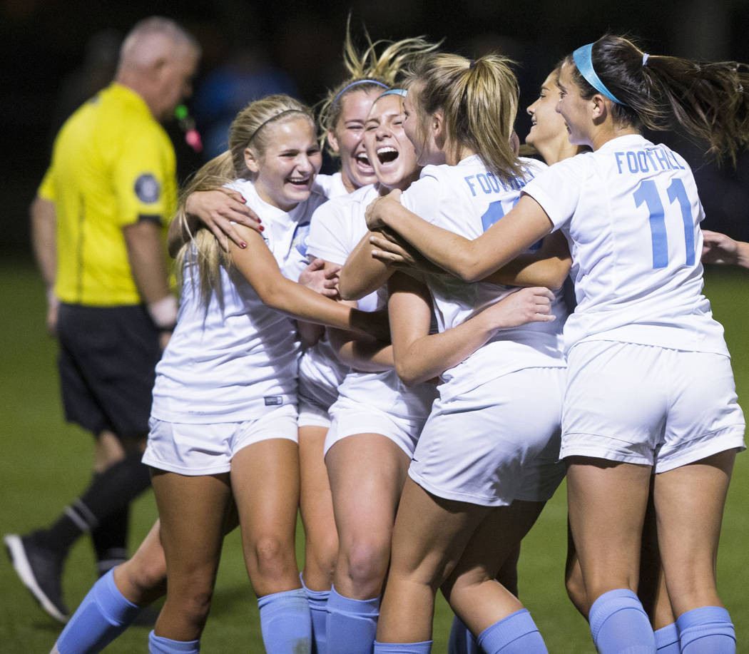Foothill High School players celebrate after scoring a last second goal in the second half t ...