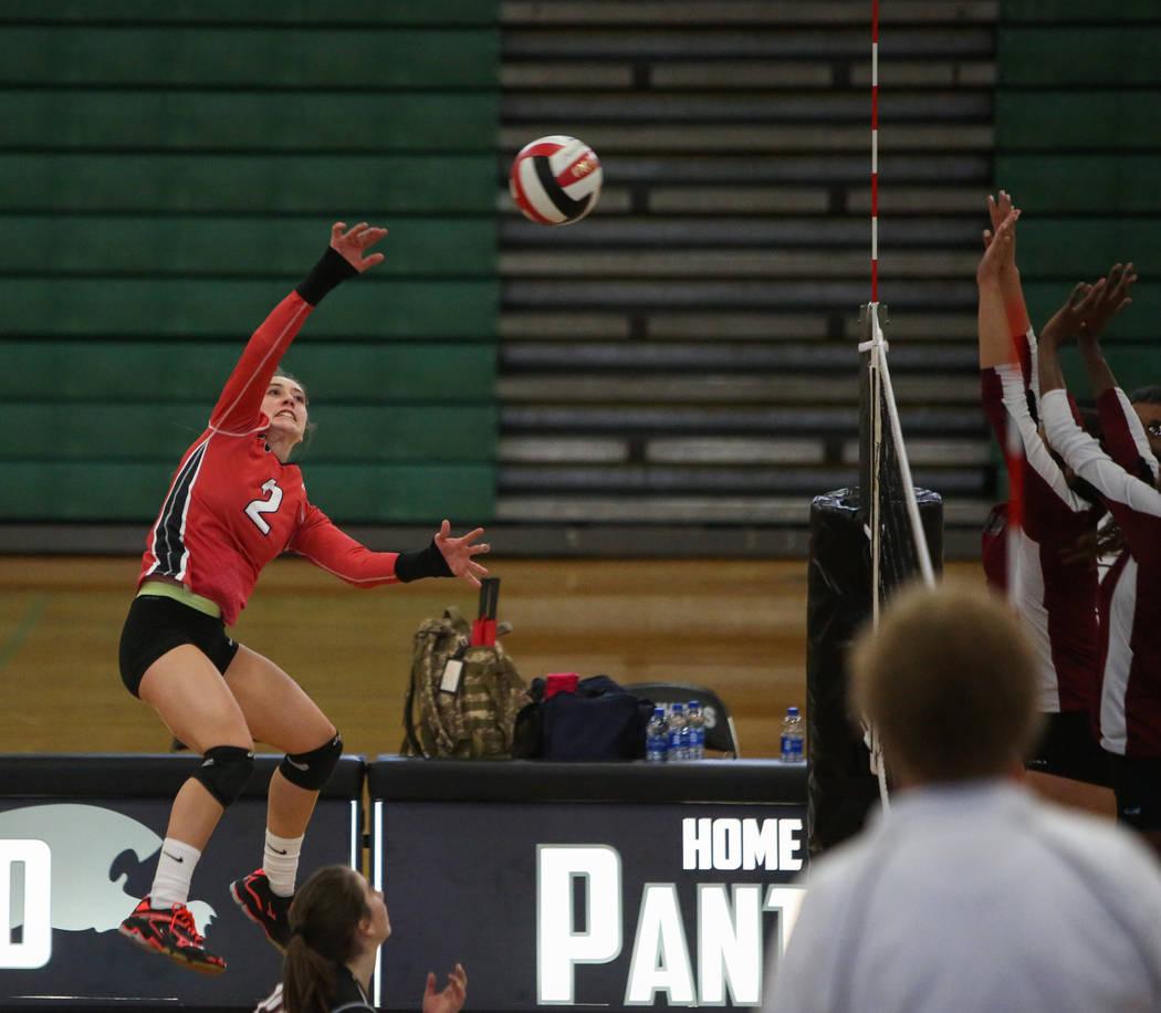 Las Vegas High School's Skyla Faught hits the ball over the net against Cimarron Memor ...