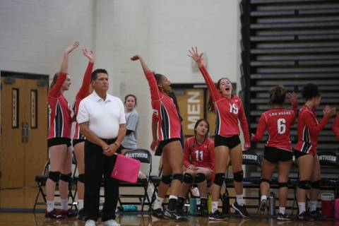 The Las Vegas High School Girls Varsity Volleyball team celebrates after winning a point aga ...