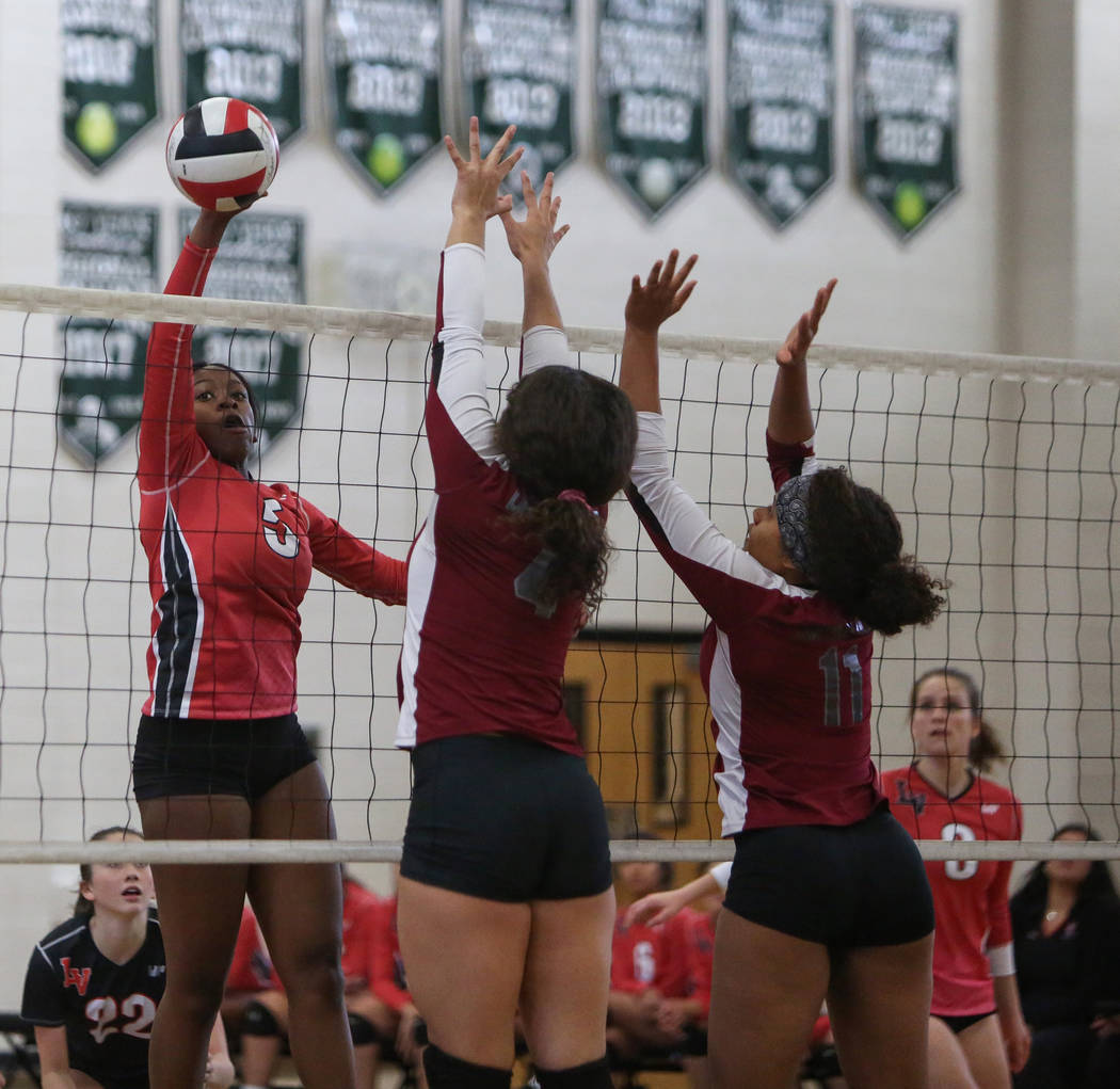 Las Vegas High School's Rimonee Wright sets the ball over the net as Cimarron Memorial ...