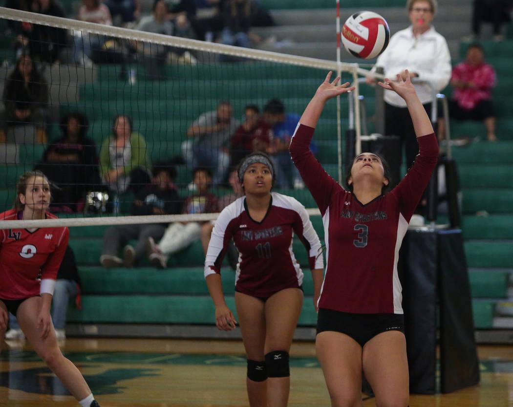 Cimarron Memorial High School's Destiny Garcia sets the ball during a game against Las ...