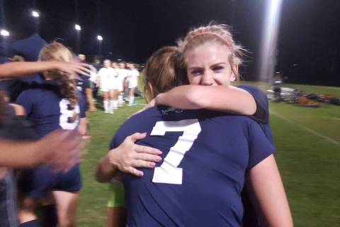 Centennial seniors Quincy Bonds and Marcella Brooks (7) embrace after the Bulldogs' 3- ...