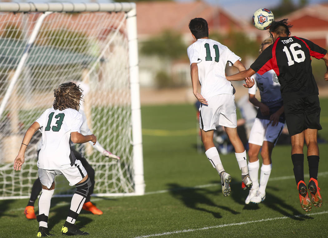 Las Vegas' Nathan Zamora (16) heads the ball past Palo Verde defenders to score a goal ...