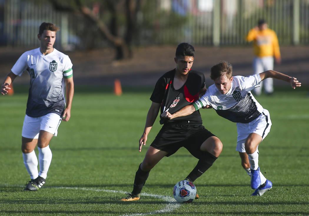 Las Vegas' Rigo Carrasco (11) battles for the ball against Palo Verde's Tanner S ...
