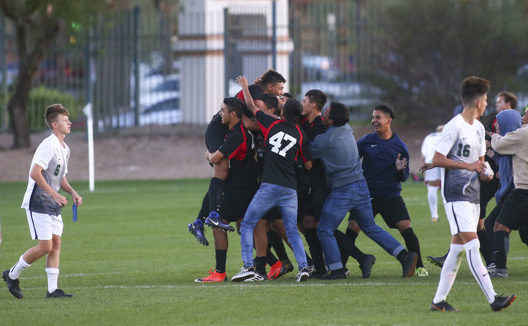 Las Vegas players celebrate their win over Palo Verde in the Mountain Region boys soccer sem ...
