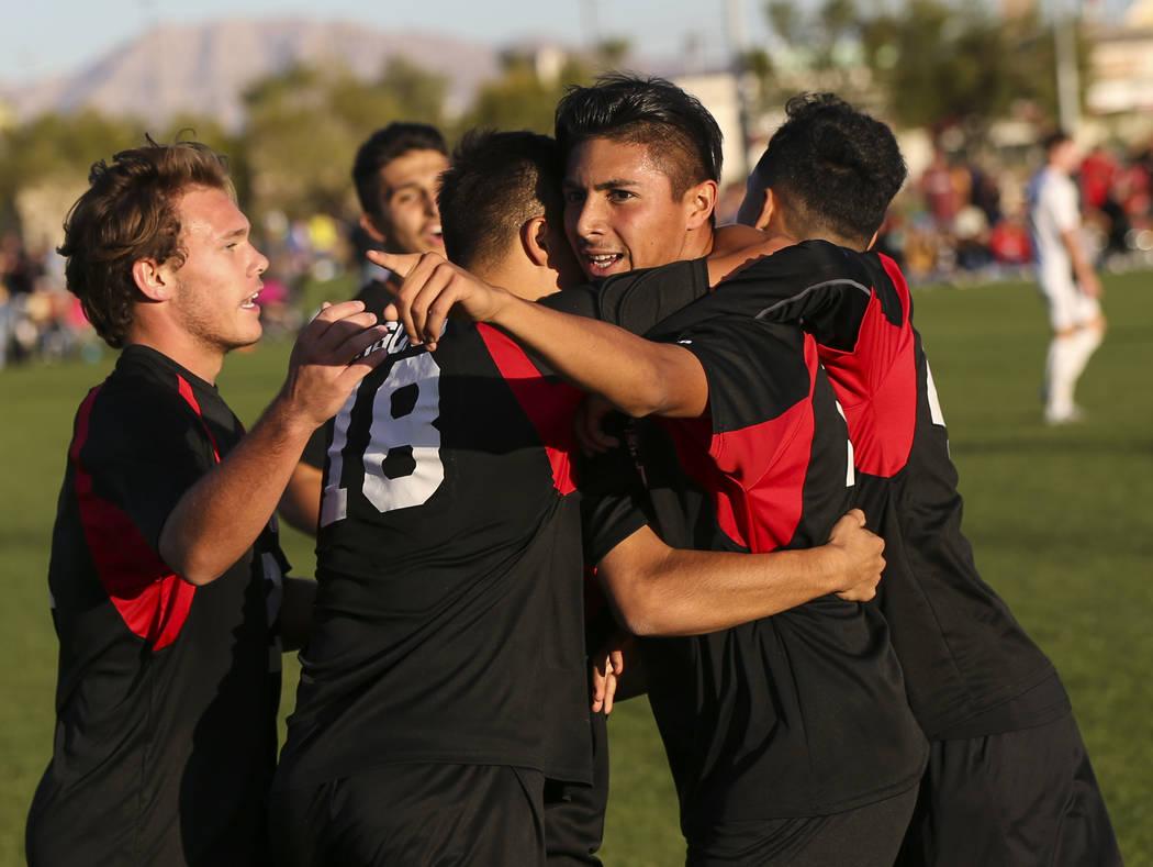 Las Vegas' Nathan Zamora, right, celebrates his goal against Palo Verde during the Mou ...