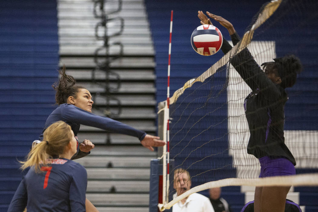 Durango's Shakayla Scarbrough blocks the ball after Coronado's Brooke Dobson sen ...