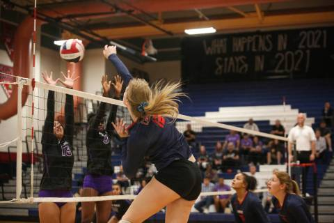 Coronado's Sasha Bolla hits the ball over the net as Durango's Anuhea Faitau, le ...