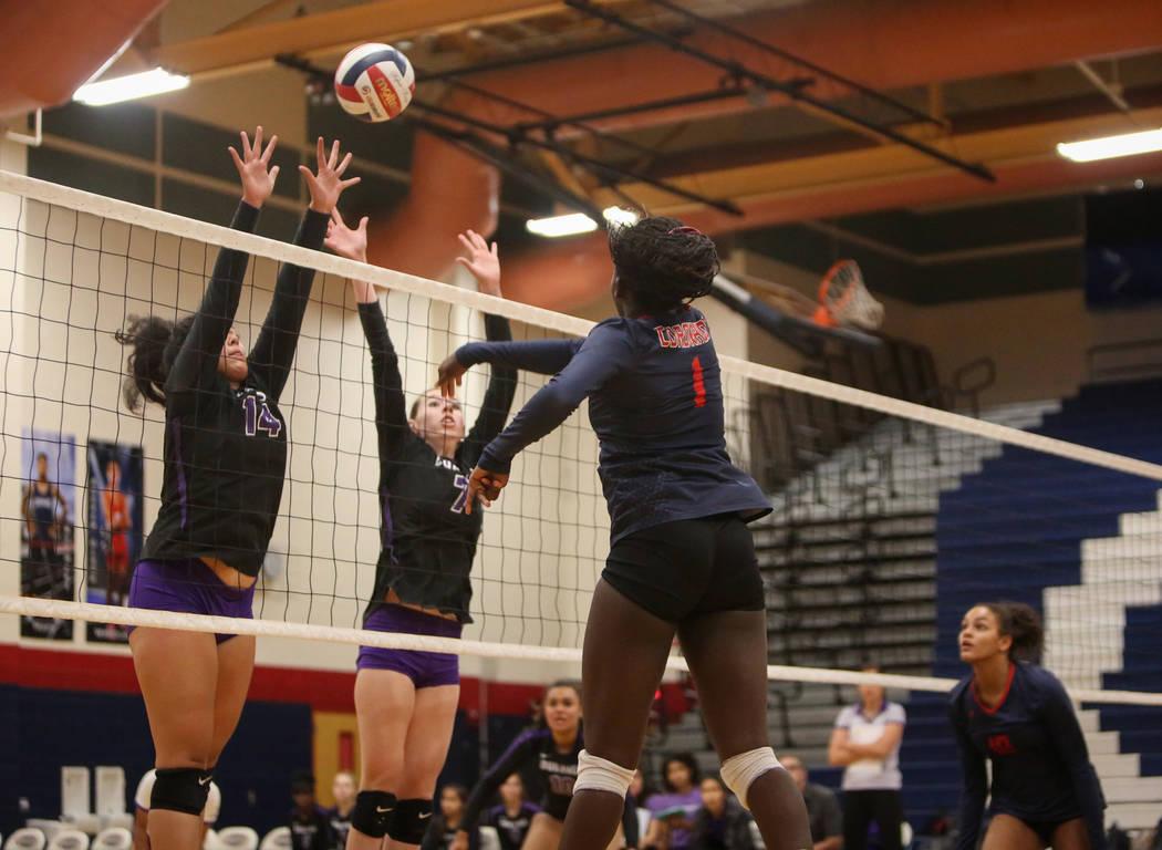 Coronado's Morenike Ajayi hits the ball over the net as Durango's Tehani Faitau, ...