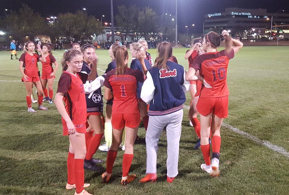 Coronado girls soccer celebrate after escaping with a 3-2 win over Desert Oasis in the Class ...
