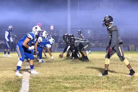 Moapa Valley football players, left, line up against Cheyenne in their Class 3A state quarte ...