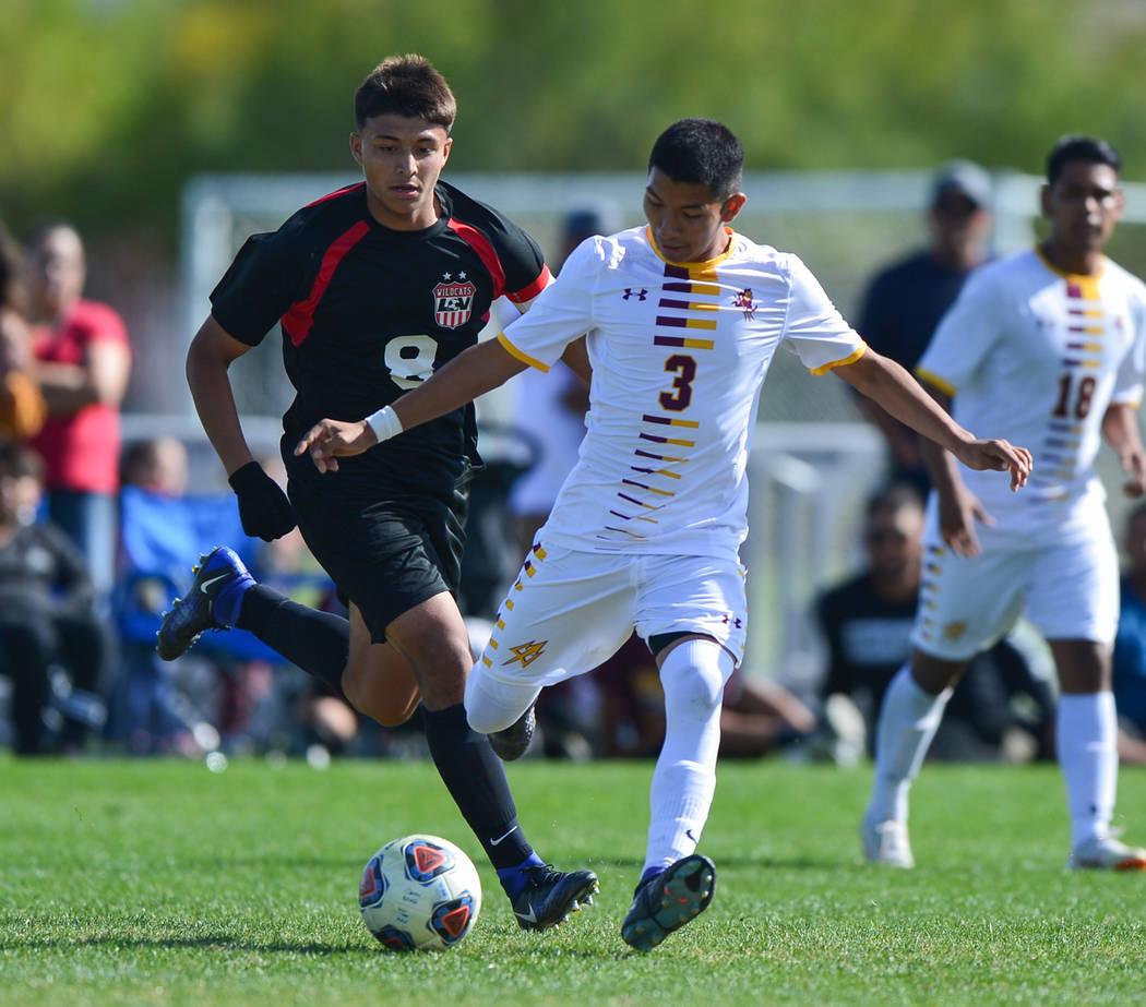 Eldorado High School's Juan Leon (3) passes the ball in front of Las Vegas High School ...