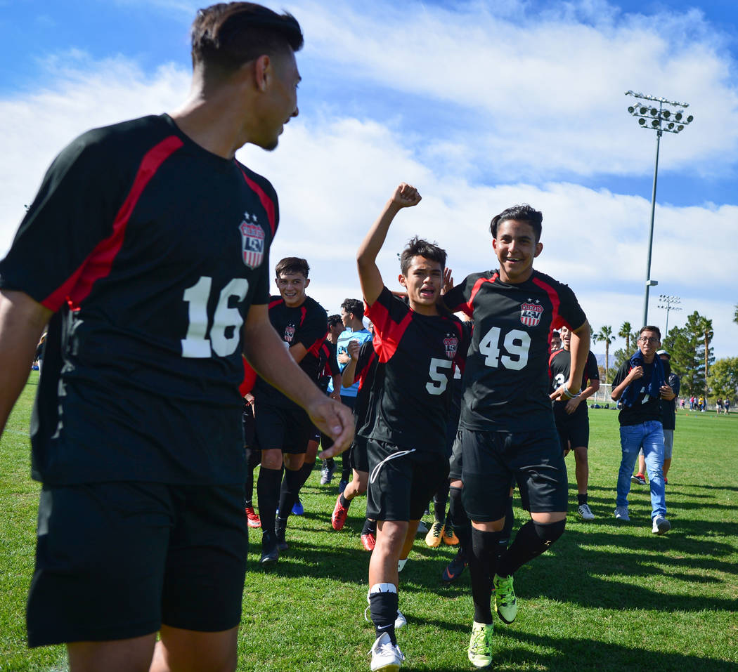 The Las Vegas High School soccer team celebrates winning the the 3A Mountain Region Champion ...