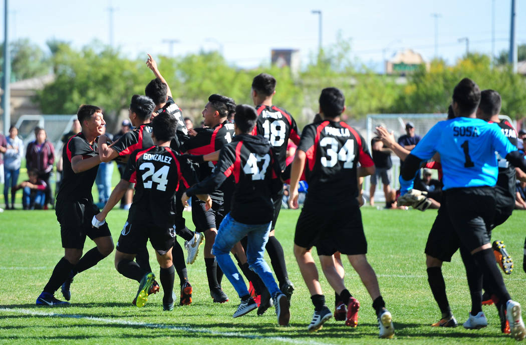 The Las Vegas High School soccer team storms the field after winning the 3A Mountain Region ...