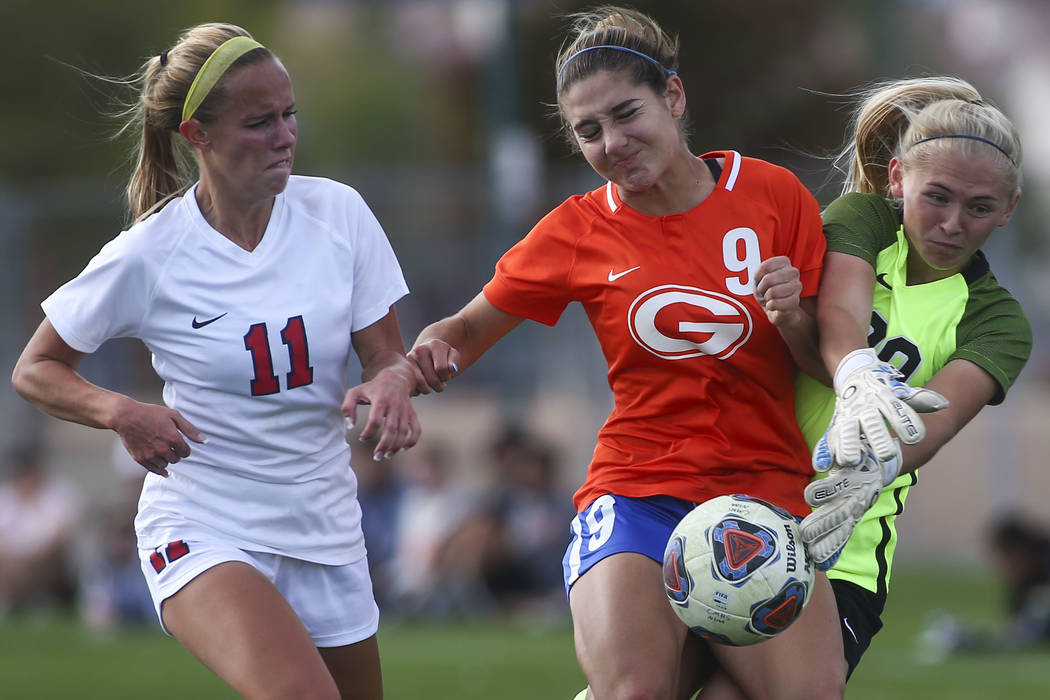 Bishop Gorman's Jaden Terrana (9) fights to maintain control of the ball against Coron ...