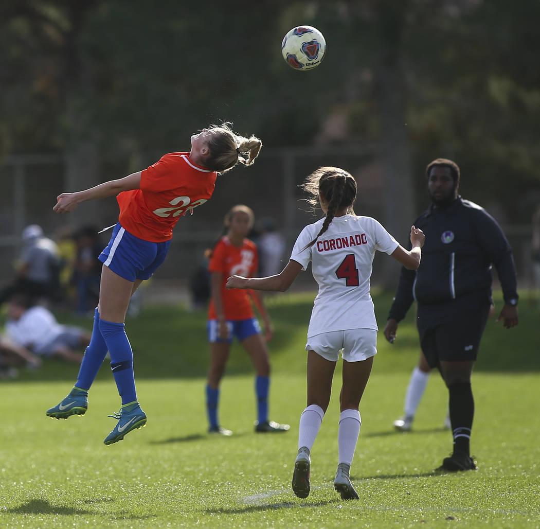 Bishop Gorman's Jacqueline Hillegas (23) heads the ball past Coronado's Chrysta ...