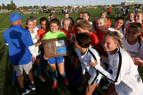 Bishop Gorman players celebrate their win over Coronado in the Desert Region girls soccer ch ...