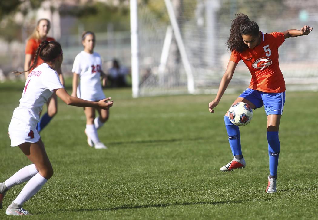 Bishop Gorman's Samantha Nieves (5) kicks the ball past Coronado during the Desert Reg ...