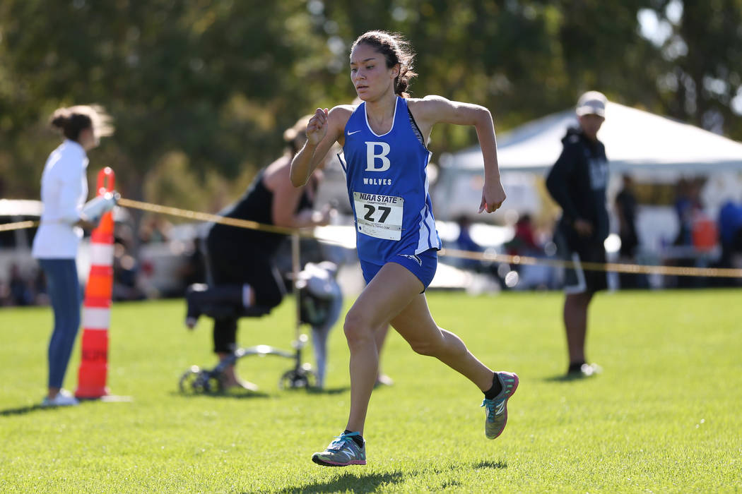 Basic's Raquel Chavez (27) makes her way to the finish line for third place during the ...