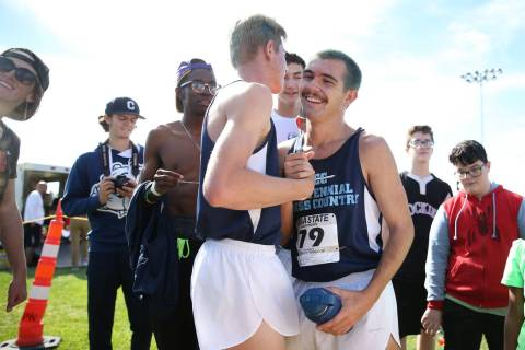 Centennial's Tucker Raymond (81), left, and Alexander Miller (79), embrace after scori ...